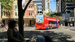 Australia Sydney sightseeing bus goes down the street Stock Footage