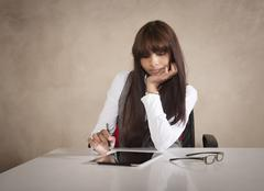 Business woman using a tablet with a stylus. Stock Photos