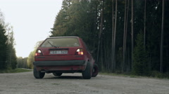 Old car drive through dirty forest roads - stock footage
