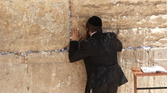 Jerusalem holy land Israel kotel western wall Jews man pray Stock Footage