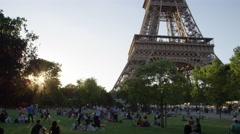 Tilt up shot of Eiffel Tower - Evening shot of Paris France's iconic monument Stock Footage