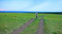 Girl goes on the field on a bicycle Health sport Stock Footage