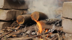 Burning wooden logs with smoke and flash fire. Stock Footage