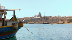 Maltese boat and skyline of Valletta Stock Footage