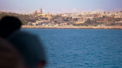 Profile of people on Malta's Ferry reaching Mgarr harbor Stock Footage
