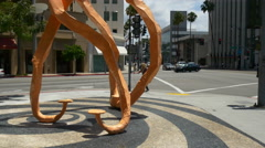 Los angeles wilshire blvd crossroad art object monument 4k usa Stock Footage