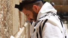 The holy land Israel kotel western wall man pray in Jerusalem  Stock Footage