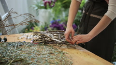 Woman in dark green apron makes crafts in art studio Stock Footage