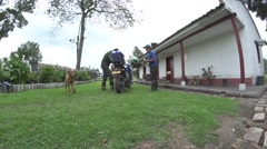 Man on motorcycle becomes Wing House of a farmer Stock Footage