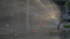 FIRE HYDRANT SPRINKLERS GIRL PLAYING Stock Footage