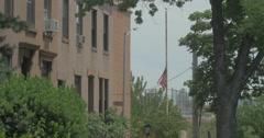 4K AMERICAN FLAG HALF MAST 1/2 MAST Stock Footage