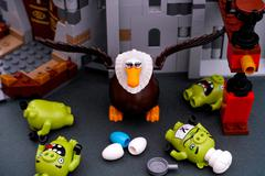 Lego Angry Birds. Four Bad piggies defeated by Mighty Eagle Stock Photos
