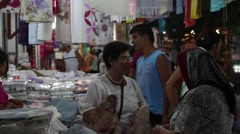 Time lapse of locals and tourists browsing stalls at a night market in Turkey Stock Footage