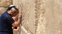 Jerusalem Israel western wall people praing Stock Footage