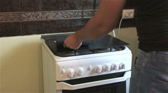 Builder in a black t-shirt measures the length of the gas stove - stock footage