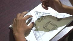 Asian boy learning and practicing to draw 3D shapes Stock Footage