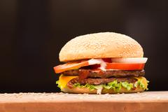 Burger with black background - stock photo