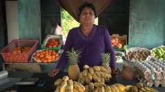 Portrait shot of indian fruit and vegetable seller in shop.Woman Stock Footage