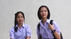 Asian Thai high schoolgirls student couple in school uniform talking - stock footage