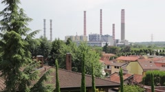 Italy turbigo the factory  chimney and the roof city near plant and blur tree Stock Footage
