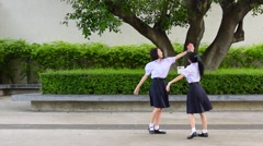 Asian Thai high schoolgirls student couple playing chasing with her friend Stock Footage