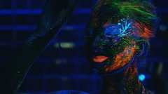 Girl dancing in the ultraviolet light Stock Footage