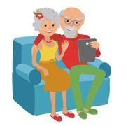 Happy senior couple sitting on the sofa read with tablet Piirros