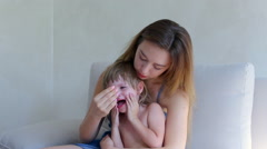 Young mother comforting crying daughter Stock Footage