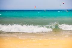 Fresh Sea Ocean Waves washing yellow sand beach Stock Photos
