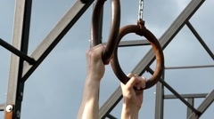 The Hands of the Athlete to Let go the Gymnastic Rings. Slow Motion. Stock Footage