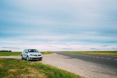 Volkswagen Polo Car Parking On A Roadside Of Country Road On A B Stock Photos