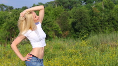 Young beautiful woman show press  abdomen workout results green background Stock Footage