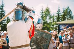 Knights In Fight With Swords. Restoration Of Knightly Battle - stock photo