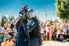 Knights In Fight With Swords. Restoration Of Knightly Battle Stock Photos