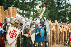Historical restoration of knightly fights. The siege of wooden fortess - stock photo