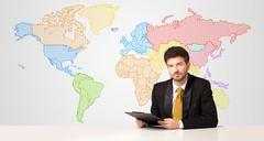 Business man with colorful world map background - stock photo