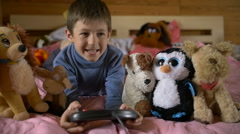 Young boy playing with a video game, game console, slow motion Stock Footage