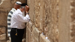 Jerusalem man pray Israel western wall Jews  Stock Footage