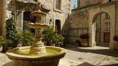 Historic fountain at Tourrettes sur Loup, South France Stock Footage