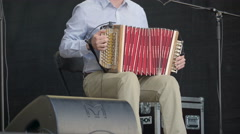 A man playing the accordion on the stage Stock Footage