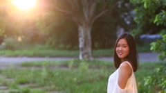 Asian girl beautiful female portrait  walking away to the sun blur in the end Stock Footage