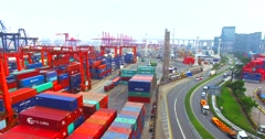 Trucks driving on road and entering the intersection in port of Hong Kong Stock Footage