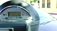 Close up of expired parking meter with car in the back Stock Footage