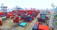 Flying above a lot of cargo containers in port of Hong Kong Stock Footage