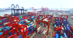 Flying above a lot of cargo containers in port of Hong Kong. Aerial. Stock Footage