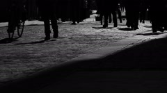 Shadows of people walking against the light - stock footage
