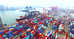 Flying backwards high above a lot of cargo containers in port of Hong Kong Stock Footage