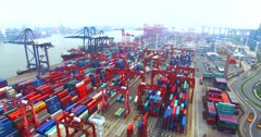 Flying high above a lot of cargo containers in port of Hong Kong Stock Footage