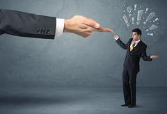 Boss hand firing guilty businessman Stock Photos