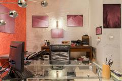 Modern artist's cluttered home atelier Stock Photos